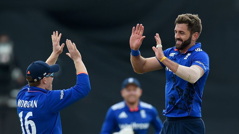 England's Liam Plunkett celebrates taking the wicket of Australia's George Bailey with Eoin Morgan (left), during the fourth match of the Royal London One