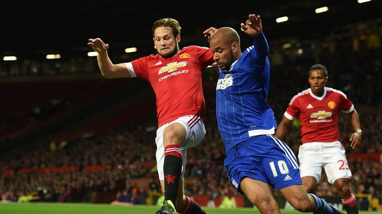 David McGoldrick (right) battles for the ball with Daley Blind