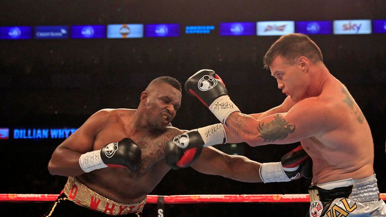 Dillian Whyte (L) lands a body shot on America's Brian Minto