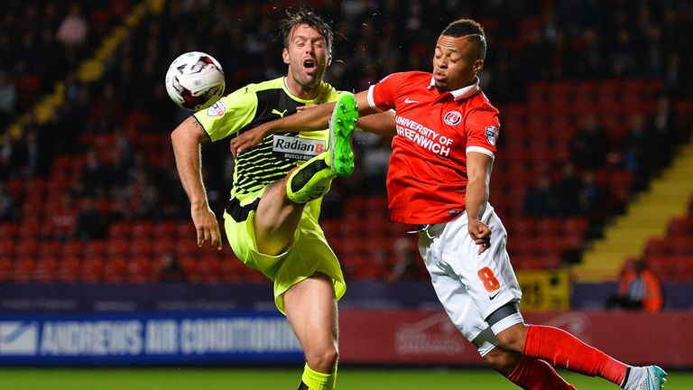Elliott Ward of Huddersfield Town and Jordan Cousins of Charlton battle for the ball