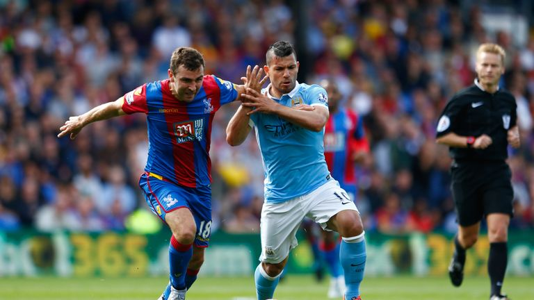 James Mcarthur Of Crystal Palace Is Challenged By Aguero Of Manchester City