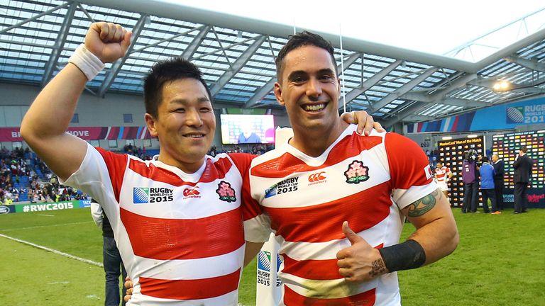 Japan's Kosei Ono and Karne Hesketh celebrate victory over South Africa