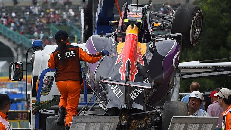 The wrecked car of Kvyat is returned to the Red Bull team