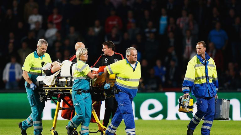 Luke Shaw of Manchester United leaves the field on a stretcher