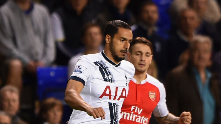 Nacer Chadli is watched by Mathieu Debuchy in the first half