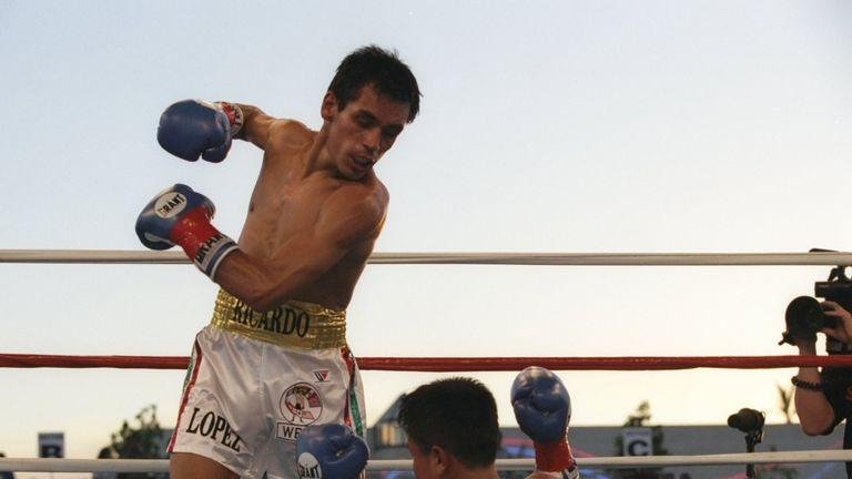 Kitichai Preecha (right) crumbles to the canvas under a Ricardo Lopez assault