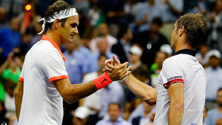 Roger Federer shakes hands with Richard Gasquet who could only win seven games during their quarter-final