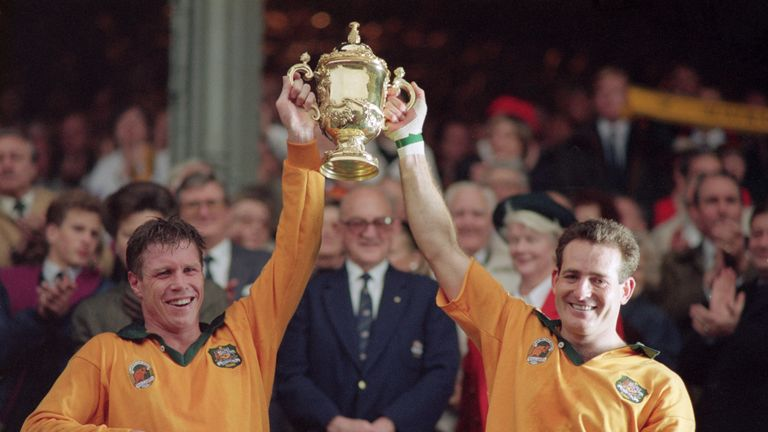 Nick Farr Jones And David Campese Lift The Webb Ellis Cup