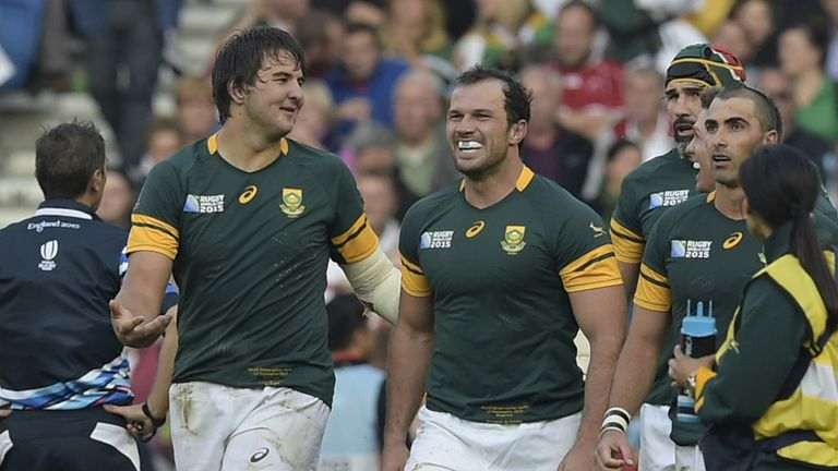 South Africa's lock Lood de Jager (L) celebrates after scoring a try against Japan