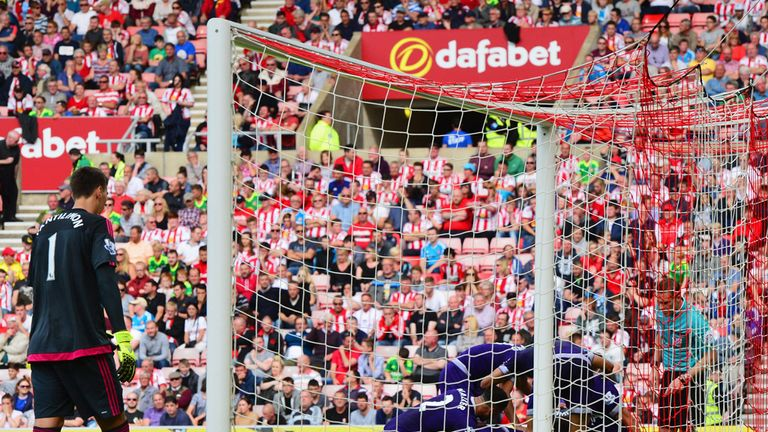 Tottenham players mob Ryan Mason after his winner at Sunderland