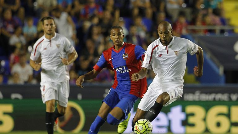 Levante's Brazilian forward Deyverson (L) vies with Sevilla's Steven N'Zonzi.