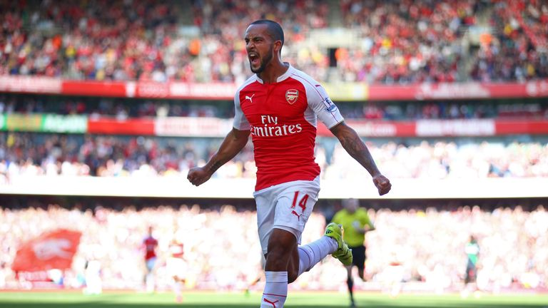 Theo Walcott has now emerged as a genuine striker for Arsenal  this season, says Henry