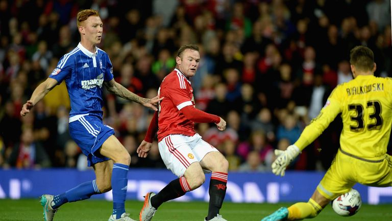 Wayne Rooney opens the scoring at Old Trafford