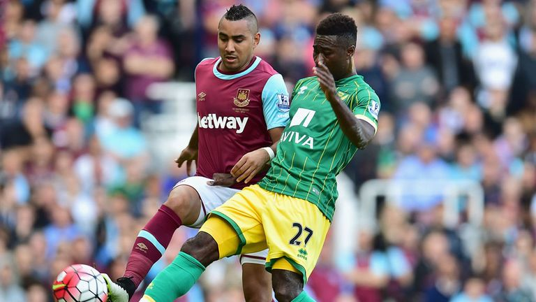 Dimitri Payet and Alexander Tettey compete for the ball during an entertaining game at the Boleyn Ground