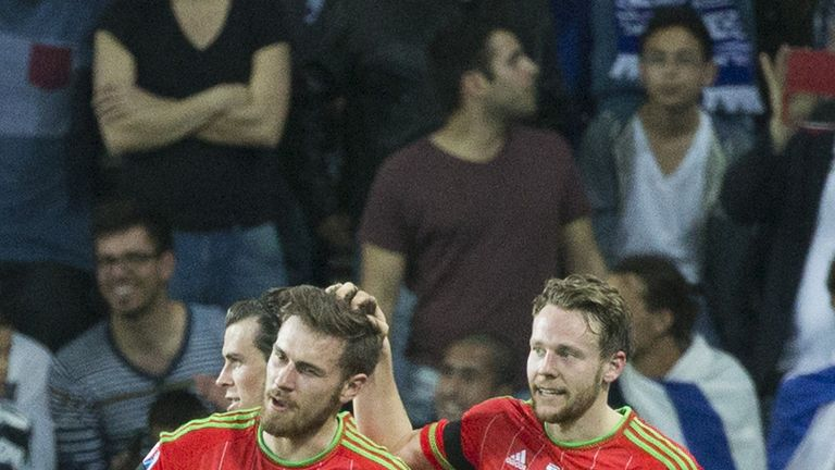 Aaron Ramsey is congratulated by his teammate Chris Gunter during the Euro 2016 qualifier between Israel and Wales