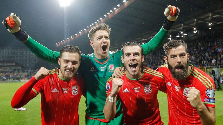 Wayne Hennessey and Joe Ledley (R) celebrate with Wales team-mates