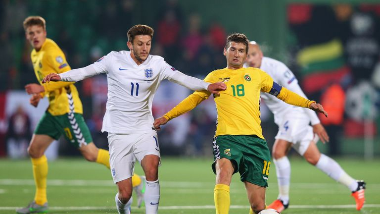 Adam Lallana competes for possession against Lithuania