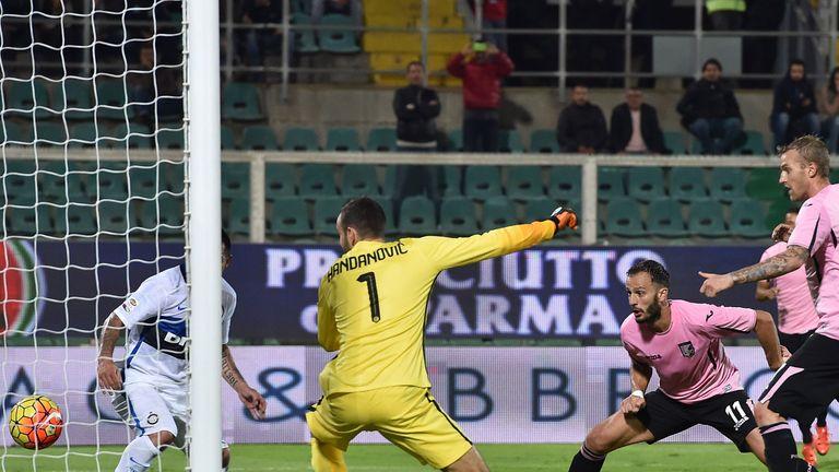 Alberto Gilardino of Palermo scores the equalising goal