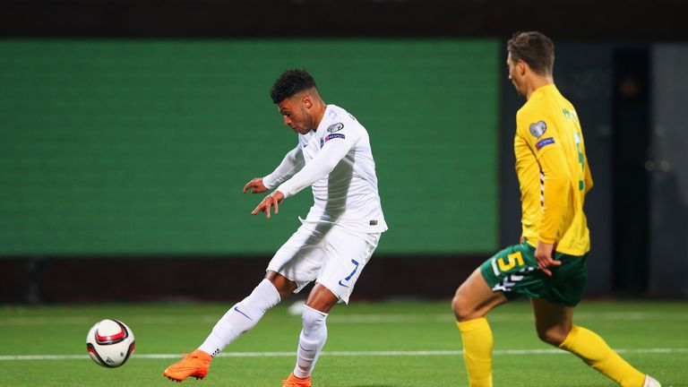 Alex Oxlade-Chamberlain (left) scored England's third with a powerful effort