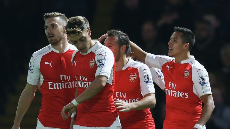 Sanchez celebrates with team-mates after scoring the first goal against Watford.
