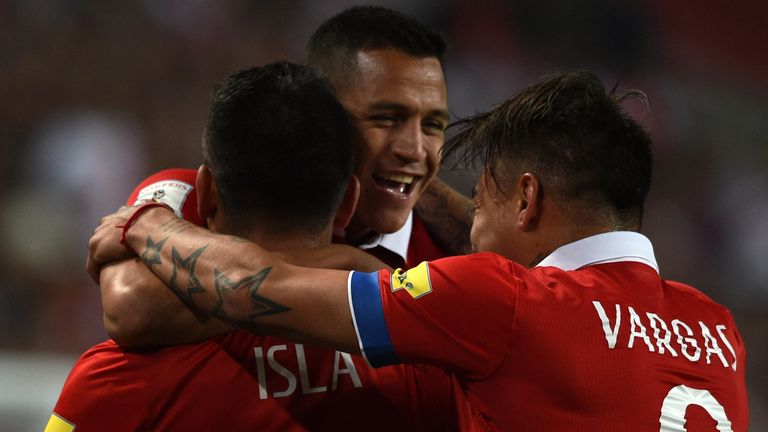 Alexis Sanchez (centre) played twice for Chile during the international break