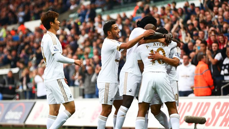 Andre Ayew celebrates with team-mates after putting Swansea in the lead
