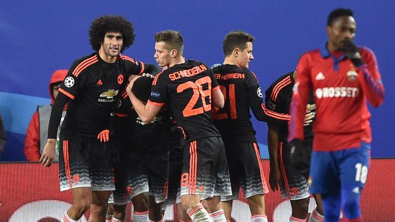 Martial is mobbed after scoring Manchester United's equaliser