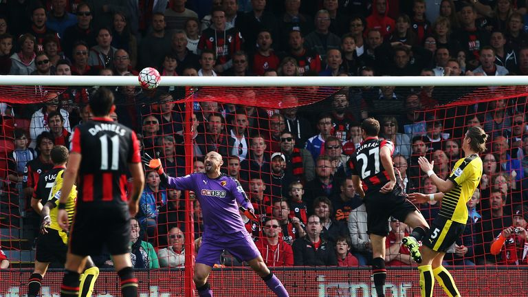 Glenn Murray headed home for Bournemouth but his late penalty was saved by Heurelho Gomes
