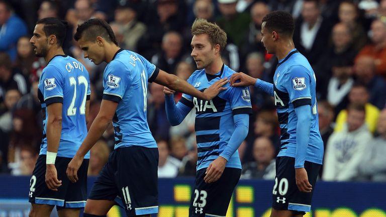 Tottenham players congratulate Eriksen after his first free-kick at the Liberty Stadium
