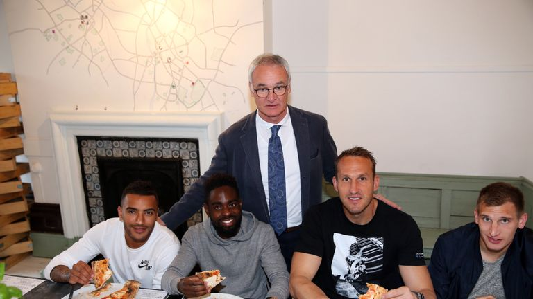 Ranieri treats his Leicester players Danny Simpson, Dyer, Mark Schwarzer and Marc Albrighton to pizza