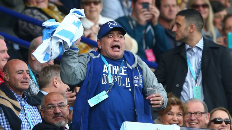 Diego Maradona celebrates Argentina's first try against Tonga