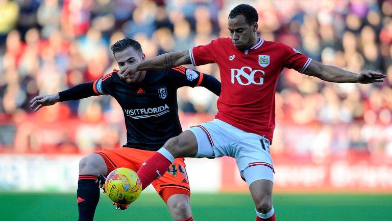 Elliott Bennett keeps the ball away from Ross McCormack