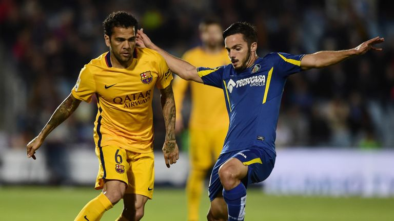 Barcelona defender Dani Alves (left) vies with Getafe midfielder Victor Rodriguez