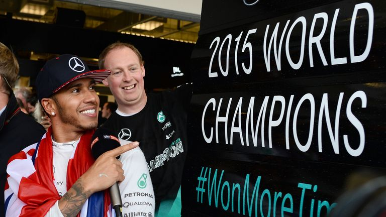 Lewis Hamilton emerged from a thrillingly unpredictable race as a three-time world champion