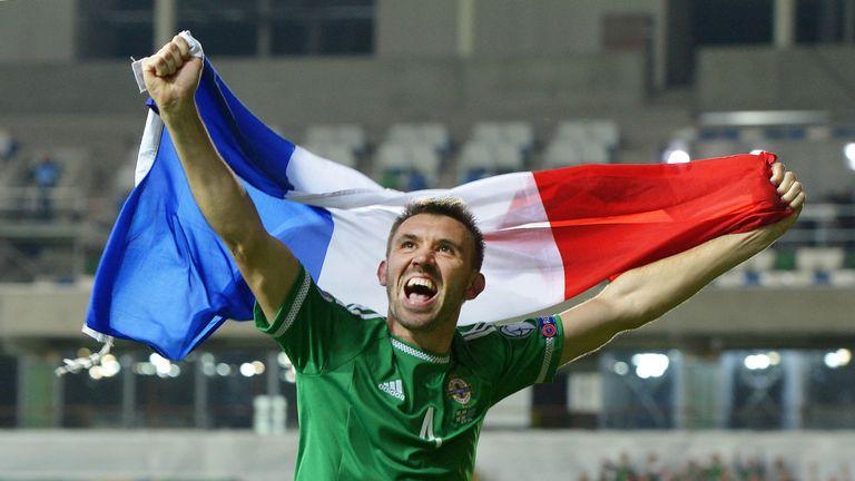 Gareth McAuley celebrates Northern Ireland clinching qualification to Euro 2016