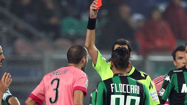 Referee Andrea Gervasono shows a red card to Giorgio Chiellini