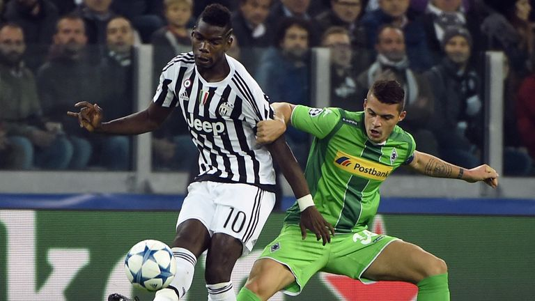 Paul Pogba vies with Xhaka in the Champions League