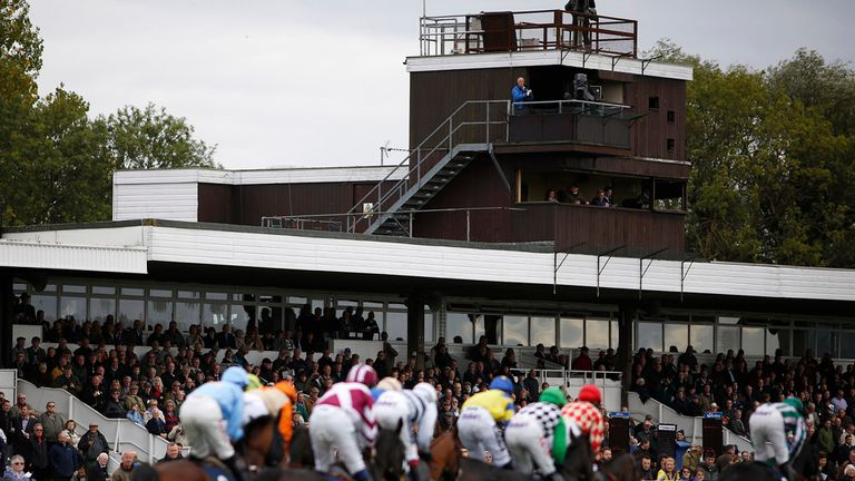 A general view as runners pass the grandstand at Huntingdon racecourse