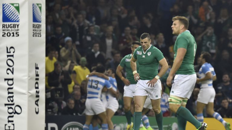 Ireland's players stand dejected as Argentina pull away in the closing stages