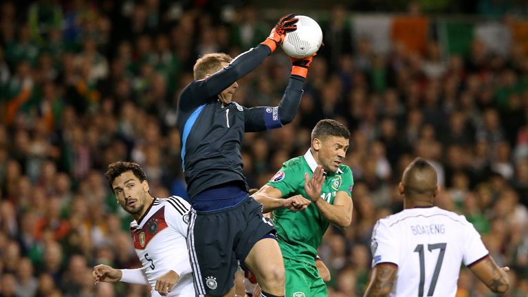 Germany goalkeeper Manuel Neuer claims a high ball above Jonathan Walters