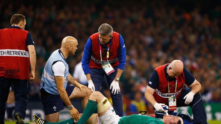 Peter O'Mahony receives medical treatment during the match between France and Ireland