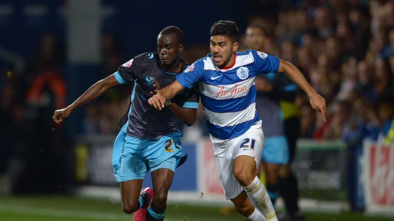 QPR's Massimo Luongo and Modou Sougou (left) battle for the ball before the Sheffield Wednesday player was injured