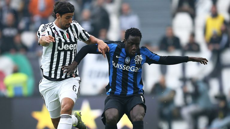 Juventus' midfielder Sami Khedira from fights for the ball with Atalanta's Boukary Drame