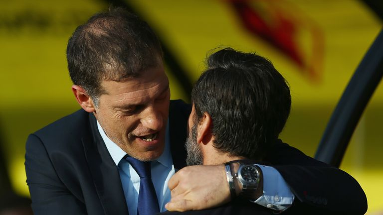 Slaven Bilic and Quique Sanchez Flores share a hug