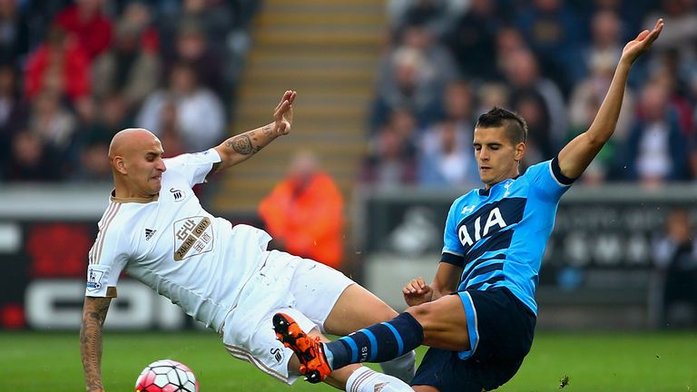 Jonjo Shelvey and Erik Lamela compete for the ball during an entertaining game in South Wales
