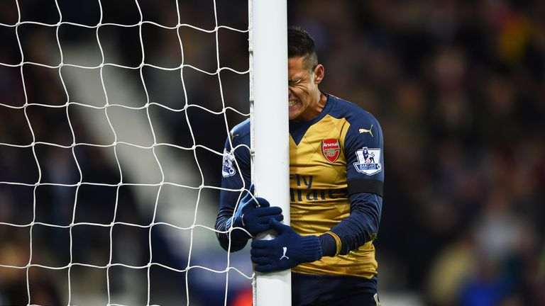 Arsenal's Alexis Sanchez reacts after missing a chance against West Brom