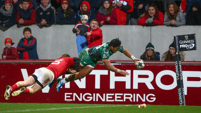 Connacht's Bundee Aki (right) scores his side's second try despite attention from Andrew Conway of Munster