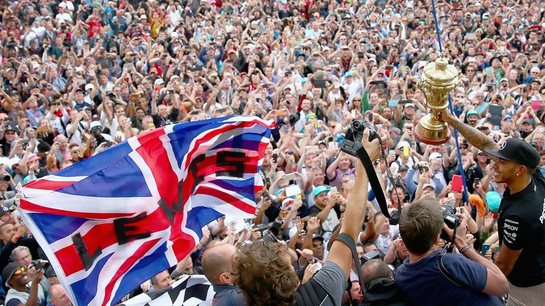The home favourite: Lewis Hamilton celebrates winning the British GP with the Silverstone crowd - Picture by Clive Mason, Getty Images