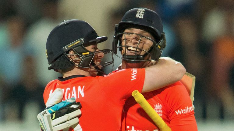 England's captain Eoin Morgan (L) and Jos Buttler celebrate their victory