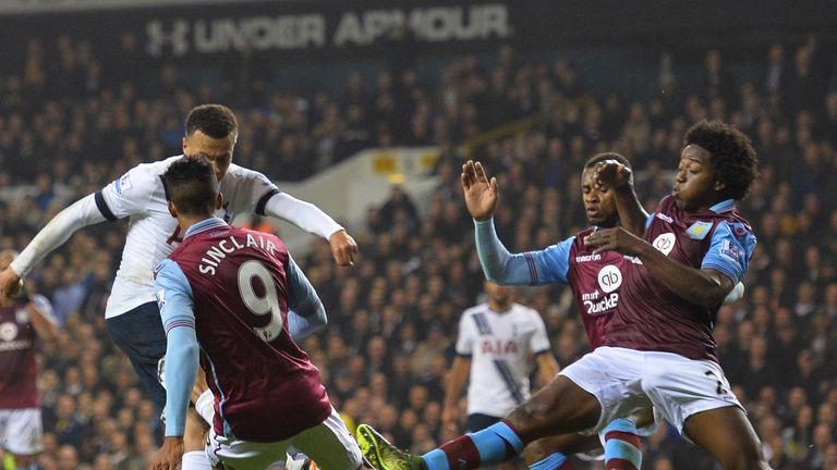Dele Alli scores Spurs' second as he volleys through a crowd of Villa defenders